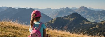 little girl looking at mountains